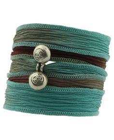 Handmade Om charm wrap bracelet. Spiritual jewelry available at BuddhaGroove.com.
