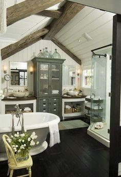 Coastal/Cottage bathroom, wood floors, cabinet between vanities, wood beams, paneled ceiling...