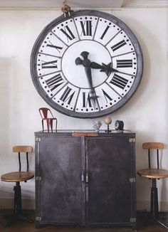 fabulous oversized clock and industrial cabinet and stools