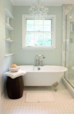 Add a little luxury to your small bathroom space by adding in a vintage chandelier and energy-efficient LEDs. paint color sherwin williams sea salt is one of the most popular green, blue, gray paint colour, good for a spa or beach theme bathroom or room Blue Green Paints, Bathroom Colors, Bathroom Inspiration, Green Paint Colors, Painting Bathroom, Upstairs Bathrooms, Beach Theme Bathroom, Bath Renovation, Sherwin Williams Paint Colors