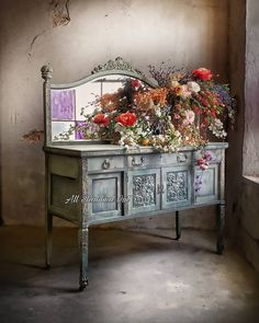 Image may contain: indoor Painted Furniture, Furniture Refinishing, Faux Flowers, Buffet, It Is Finished, Artsy, Indoor, Cabinet, Storage
