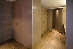 Ironwood Manufacturing laminate with Zenolite toilet partitions and bathroom door. Upscale, clean public restroom stalls.