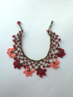 Handmade crocheted necklace decorated with cute crochet flowers and natural stones. All of the necklaces will be prepared with utmost care and sent in bubble envelopes. Measurement Total Length 46 cm / 18,11 inches ***Ready to ship!*** PS: Please note that light effect,