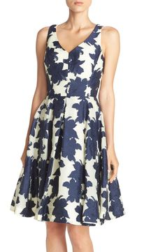 Bold, midnight blue flowers create a chic look on this fit & flare dress.