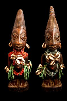 """Ibeji Figures. Yoruba Tribe. The Yoruba are a  major African ethnic group where, within their culture, twins are very important beings. In their language """"ibeji"""" means """"twins"""" as well as the carved wooden figures made to house the soul of a dead twin. They are known to have the highest rate of twin births in the world, 45 of every 1,000 births. Location: Nigeria. See more at londoncoin.com"""
