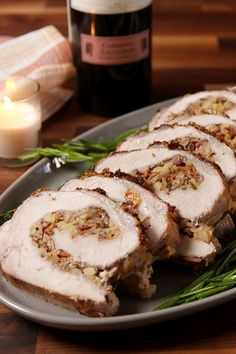 How to wow holiday dinner guests? Stuffing a pork loin with more bacon. Get the recipe fromDelish.