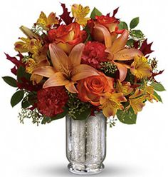 Bring over a fall bouquet as a host gift for your next dinner party. They'll fall for you in no time. #fall #bouquet