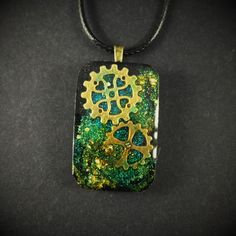 Blue Green Gold Glitter Steampunk Resin Pendant Necklace by ManabizzleCreations on Etsy
