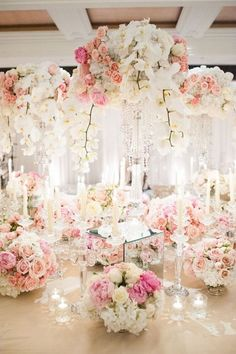 Classy wedding centerpiece idea via Leila Brewster Photography / http://www.himisspuff.com/tall-wedding-centerpieces/4/