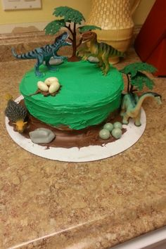 Dinosaur cake.  Very easy to decorate with toy dinos & candy for dinosaur eggs.