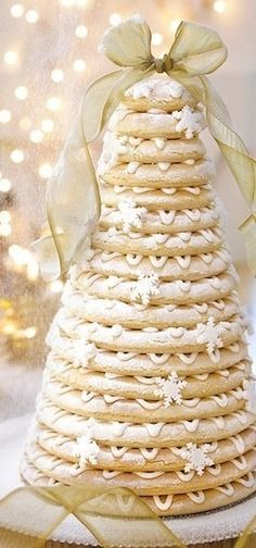 Kransekake - Traditional Scandinavian Christmas/New Year's Eve/Wedding Cake. This was our wedding cake. Gold Christmas, Christmas Goodies, Christmas Desserts, Christmas Treats, Christmas Baking, Christmas Time, Christmas Wedding, Christmas Cakes, Beautiful Christmas