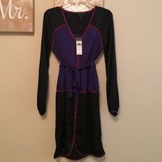 BCBG celestial polyester dress Very silk like long sleeved dress with what I love .... two front pockets !!! Tricolored black, magenta trim and purple center. Has a tie around at waist. BCBGMaxAzria Dresses Midi