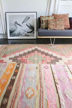 A great brightly colored area rug will help make any dorm room a little more unique.