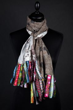 IDEA ONLY - strips of pretty colorful fabrics (edges overlocked) looped and used as scarf fringe!!  So pretty!