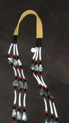 Abalone and Dentalium Necklace, three strands on leather hide.