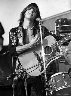 Gram Parsons, originator of Country Rock music  and member of The  Flying Buritto Brothers playing at the  Altamont Speedway, Livermore, CA December 6, 1969