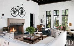 Sheryl Crow at Home in Architectural Digest via Greige This is a gorgeous great room. Love the vintage bicycle over the fireplace and the vintage chest of drawers in the corner. Interior Trim, Home Interior, Modern Interior, Interior Design, Mansion Interior, Architectural Digest, Spanish Colonial Homes, Spanish Style Homes, Spanish Revival