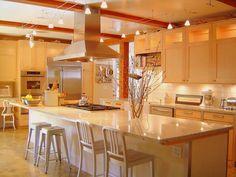 Bright kitchen: task lights, maple cabinets, white subway tile