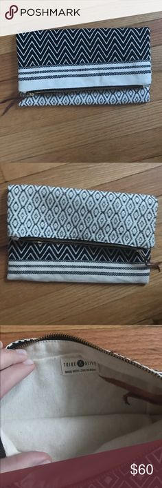 Tribe Alive reversible clutch Brand new handmade clutch! Can be worn with either the darker or lighter pattern showing the most! Super roomy and versatile Tribe Alive Bags Clutches & Wristlets