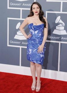 Hilarious and sardonic Kat Dennings showed off her megawatt curves with a short Vivienne Westwood number that highlighted her toned calves and slender ankles (if you could look past that un-freaking-believable décolletage!).