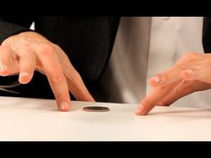 How to Do the Coin through a Table Trick | Coin Tricks - Great party trick