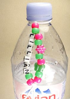 Alphabet Bead Water Bottle Collar...would be perfect at our house because I always find half empty bottles of water around the house from the kids. Doing this today!