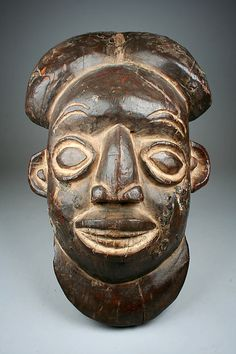 Helmet Mask Date:19th–20th century Geography:Cameroon, Grassfields Culture:Cameroon Medium:Wood, meta, pigment Dimensions:H. 15 7/8 x W. 10 x D. 6 1/2 in. (40.3 x 25.4 x 16.5 cm)