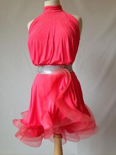 """Gorgeous and bright design from Dance Sport International of London. Stretch crepe and mesh on back bodysuit. Perfect for all Latin and rhythm dances. Body suit and bra cups. Swarovski stones. Best for sizes from 4-6 and heights from 5'2"""" to 5'6"""" This dress can be rented for $199 or purchased for $800"""