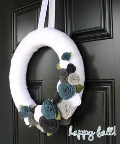 yarn wreath...love the colors of felt flowers