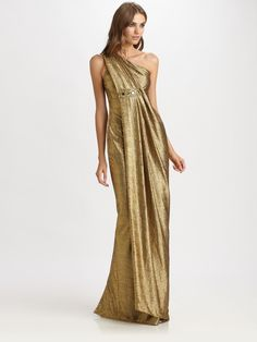 This glamorous, artfully draped design is rendered in shimmering gold lamé. Description from lyst.com. I searched for this on bing.com/images