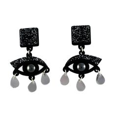 The drop eye earrings are made from laser cut black perspex, and embellished with a sparkly pop of black glitter, hematite cabachons and silver mirror perspex t