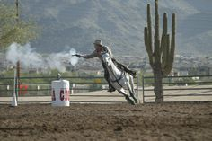 John Dotson and Quincy At a Cowboy Mounted Shooting competition.