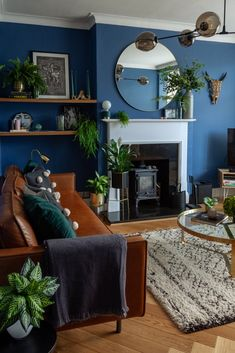 I was asked to help bring charater and warmth to this new kitchen extension & lounge. Blue Feature Wall Living Room, Navy Living Rooms, Dark Blue Living Room, Blue Living Room Decor, Accent Walls In Living Room, Eclectic Living Room, Boho Living Room, Dark Blue Lounge, Dark Blue Rooms
