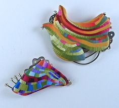 Brooches by J.M. Syron and Bonnie Bishoff, polymer clay.