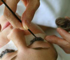 What does eyelash tinting involve?