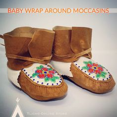Baby Moccasins made out of Stroud fabric, caribou hide, beaver fur and string ties.  Made by Tłı̨chǫ artisan, Mabel Huskey of Behchokǫ̀, NT