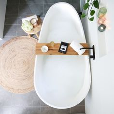 Beautiful bathroom styling in the home of Shelley with this egg bath and black tapware