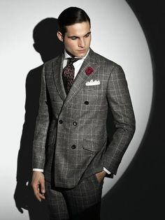 Pairing a grey double breasted blazer with grey dress pants will create a powerful and confident silhouette.  Shop this look for $282:  http://lookastic.com/men/looks/pocket-square-and-tie-and-dress-shirt-and-double-breasted-blazer-and-dress-pants/756  — White Pocket Square  — Dark Brown Tie  — White Dress Shirt  — Grey Double Breasted Blazer  — Grey Dress Pants