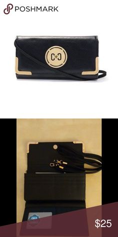 "LAST ONE Coco + Carmen Medallion Crossbody Wallet 2 in 1 Wallet + Crossbody with detachable strap. Small size big statement. Organizes all your basics and wraps them in vegan leather, plus a gold-tone medallion.  Material: Vegan leather Dimensions: 7.5""W x 4""H x 0.75""D Bags Crossbody Bags"
