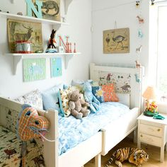 cute cheery cushions, wooden shelves display favorite things.