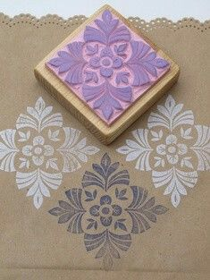 I luv everything about this pic! Brown paper with lacy edge, and the beaty stamp!