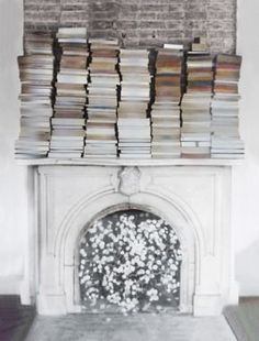 Mantle covered in books