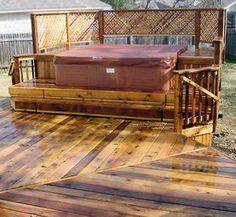 custom deck with hot tub enclosure #southridgebuildingandremodeling