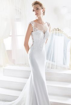 Nicole romantic and sensual mermaid dress in soft cady, tulle and dot tulle with beaded macrame lace and rebrode border lace.