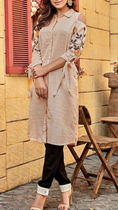 Beautiful Cotton kurti with cold shoulder and modern detailing. Kurti Sleeves Design, Sleeves Designs For Dresses, Dress Neck Designs, Sleeve Designs For Kurtis, Simple Kurti Designs, Kurta Designs, Blouse Designs, Casual Formal Dresses, Stylish Dresses