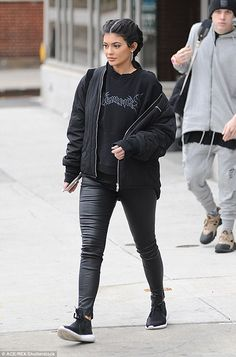 Supporting Yeezy: Later on the KUWTK wore leather look leggings with some black Adidas sne...