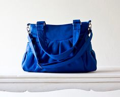 cute bright blue bag.  with convertible straps, too.  LOVE!
