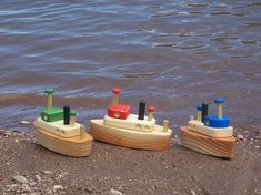 Adorable handmade wooden tug boat for hours of playtime fun. Constructed of various woods brightly finished with non-toxic waterbased paint and organic coconut oil. Specify red, blue or green color upon placing order. Not a toy to be used in the water because it will damage the finish of the wood! Ages 2+ Measures: 7x2 3/4x4 3/4