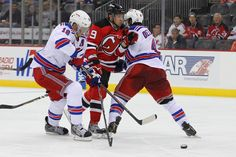 CrowdCam Hot Shot  New Jersey Devils left wing Mattias Tedenby is hit by New  York Rangers defenseman Michael Del Zotto and defenseman Marc Staal during  the ... 5bb19faee