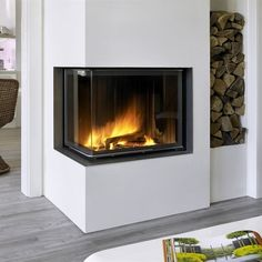 Corner fireplace boiler, tiled stove heating by Brunner GmbH Home Fireplace, Modern Fireplace, Fireplace Design, Corner Fireplaces, Scandinavian Interior, Living Room Interior, Built Ins, Great Rooms, New Homes
